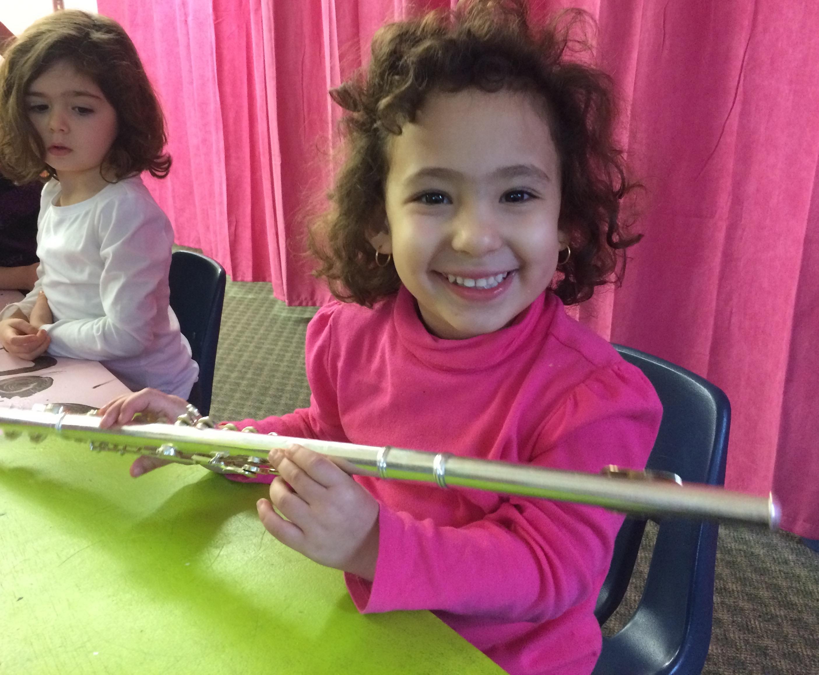 Holding Teacher Kenzies Flute
